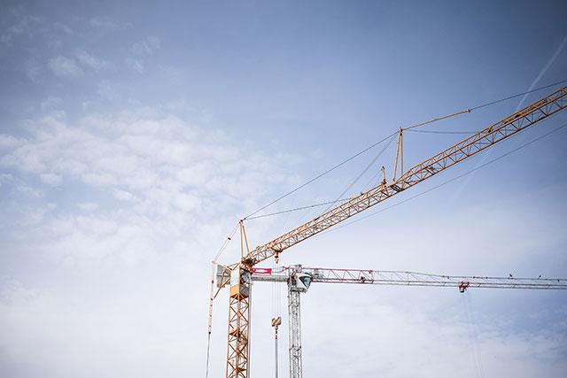 big-lifting-cranes-at-construction-site-picjumbo-com